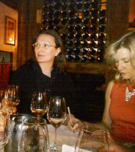 Rosaria and Melanie at the wine tasting event: listening, learning, and taking notes