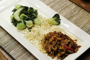 Spicy Duck & Bok Choi over noodles