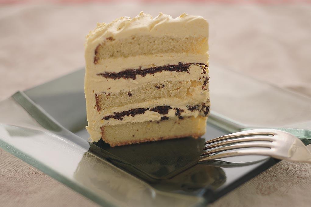 Slice of Butterless Buttercream Cake with Hazelnut Pralines