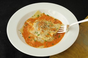 Veal stuffed ravioli with sweet red pepper sauce