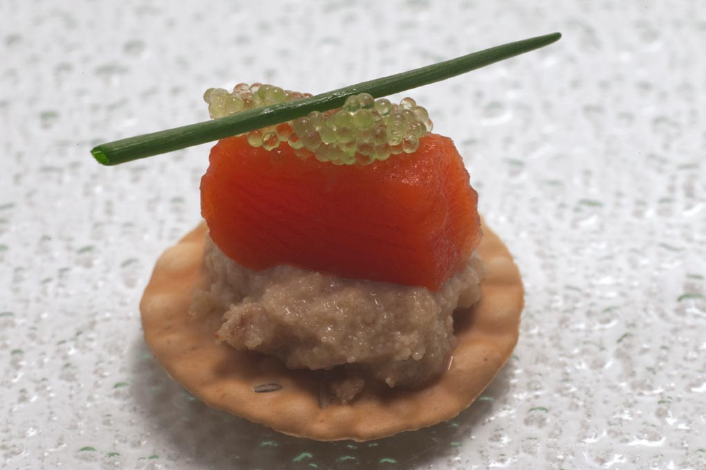 Roe cream with salted salmon and wasabi caviar on mini-papadum