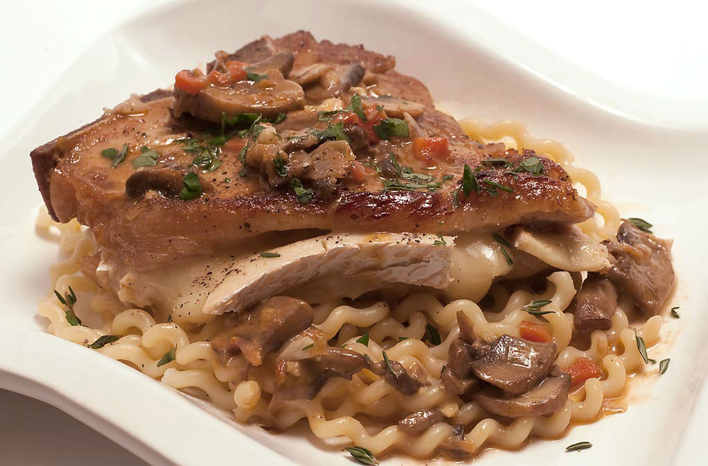 Brie-stuffed veal chop over fusilli pasta w/ veal reduction sauce