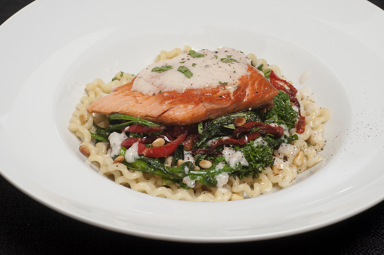 Salmon over pasta with broccoli rabe & red peppers